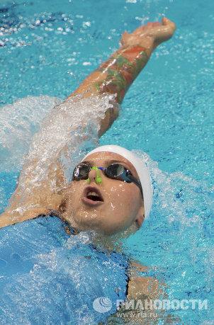 На фото: спортсменка Оксана Савченко в заплыве на 100м на спине во время соревнований по плаванию на ХIV летних Паралимпийских играх в Лондоне.