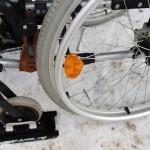 В инвалидном кресле по снегу
