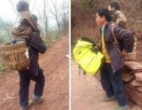 Китаец носит сына в школу на спине, преодолевая 30 км ежедневно