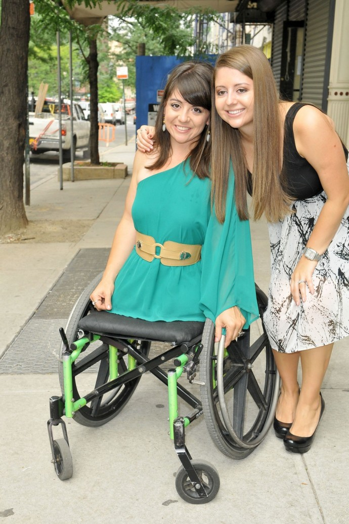 "Jen Bricker, the long-lost sister of Romanian-American gymnast Dominique Moceanu who was born without legs, poses outside the ""Wendy Williams Show"""