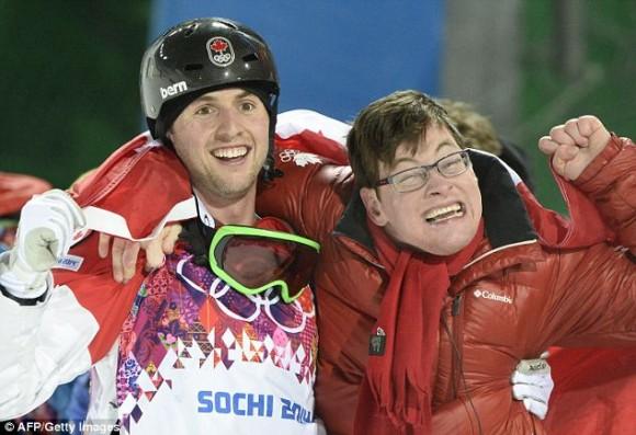 Паралимпиада. Канадский лыжник Алекс Билодо празднует поеду со своим братом, больным ДЦП